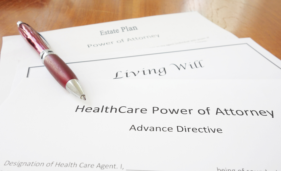 Health care power of attorney document on a table with a pen.